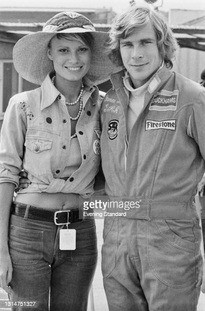 British racing driver James Hunt with his fiancée, fashion model Suzy Miller during the 1974 British Grand Prix at Brands Hatch, UK, 20th July 1974.