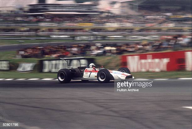 British racing driver John Surtees driving his Honda RA301 in the British Grand Prix at Brands Hatch 20th July 1968