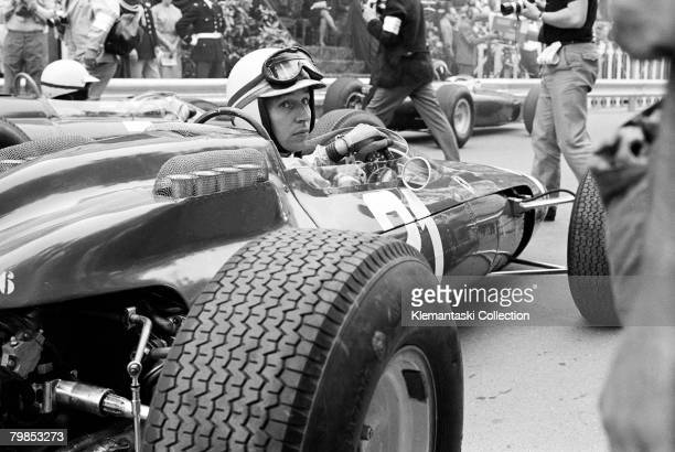 British racing driver John Surtees on the grid at the Monaco Grand Prix Monte Carlo as the practice flag is about to fall 10th May 1964 He had a DNF...