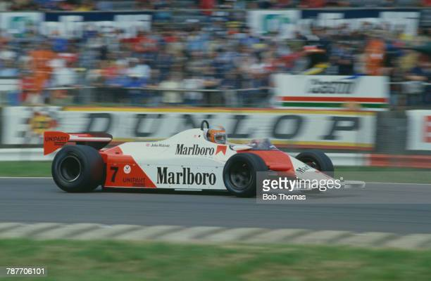 British racing driver John Watson drives the Marlboro McLaren International McLaren MP4 Ford Cosworth DFV 30 V8 to finish in first place to win the...