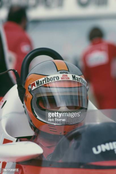 British racing driver John Watson pictured in the driver's seat of the Marlboro McLaren International McLaren MP4 Ford Cosworth DFV 30 V8 prior to...