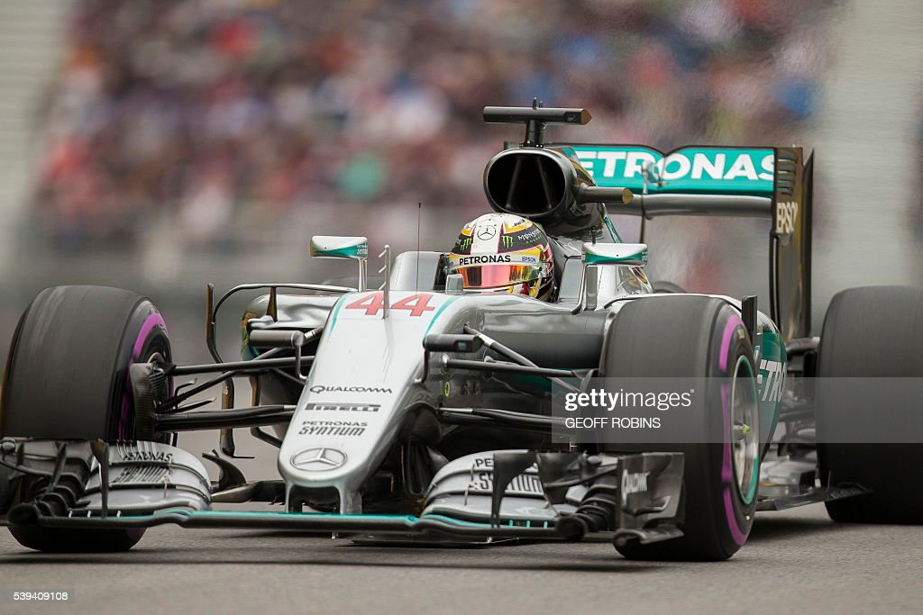 British racing driver Lewis Hamilton of Mercedes accelerates up the hill after turn 2 on the Circuit Gilles Villeneuve in Montreal during a morning practice session for the Canadian Formula 1 Grand Prix on June 11, 2016. / AFP / GEOFF