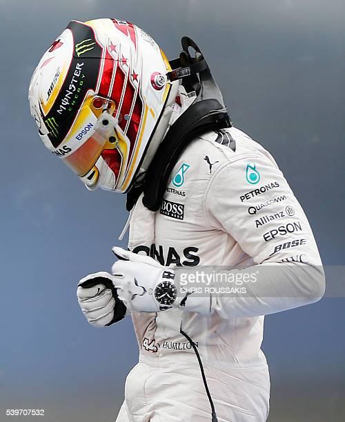 British racing driver Lewis Hamilton of team Mercedes AMG celebrates after winning the Canadian Formula 1 Grand Prix at the Circuit Gilles Villeneuve...