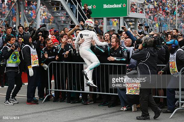 British racing driver Lewis Hamilton of team Mercedes AMG celebrates with his team after winning the Canadian Formula 1 Grand Prix at the Circuit...