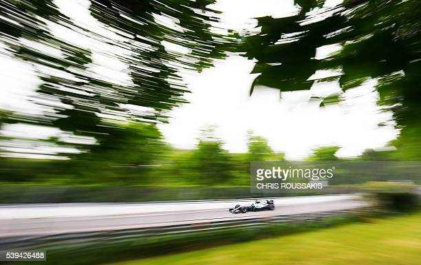 TOPSHOT British racing driver Lewis Hamilton of team Mercedes AMG makes his way through the track during the qualifying session for the Canadian...