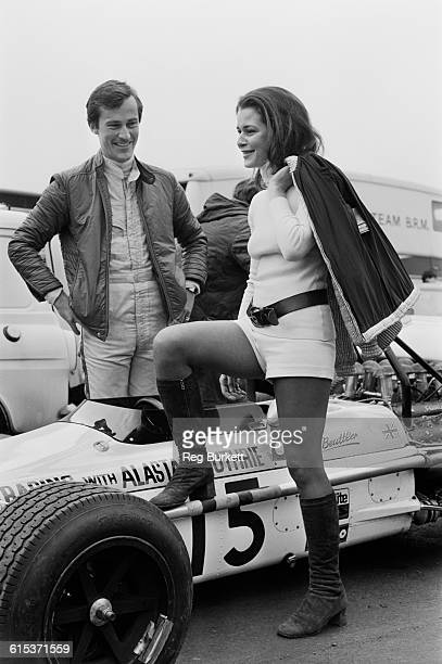 British racing driver Mike Beuttler at Brands Hatch in Kent England with friend Anne Ries 20th March 1971