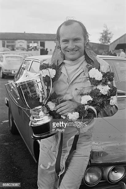 British racing driver Mike Hailwood wins the Uniflo Trophy in round 11 of the 1971 Rothmans F5000 European Championship at Silverstone, UK, 14th...