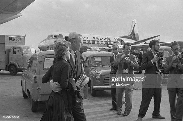 British racing driver Mike Hawthorn arrives at London Airport with Louise Collins the wife of fellow racing driver Peter Collins UK 4th August 1958...