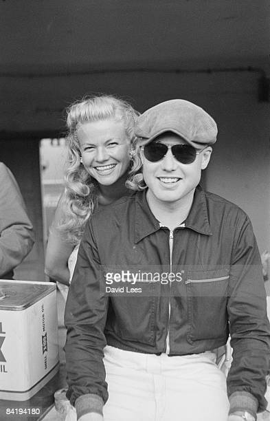 British racing driver Mike Hawthorn with a friend at Monza for the Italian Grand Prix 5th September 1954 Original publication Picture Post 8156 Monza...