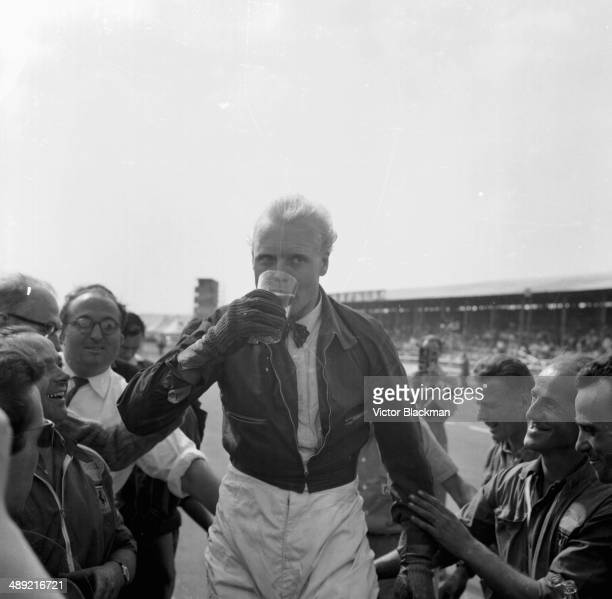British racing driver Mike Hawthorn with a pint of lager after finishing second at the British Grand Prix Silverstone July 19th 1958