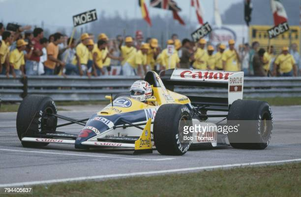British racing driver Nigel Mansell drives the Canon Williams Williams FW12 Judd CV 35 V8 in the 1988 Brazilian Grand Prix at the Autodromo...