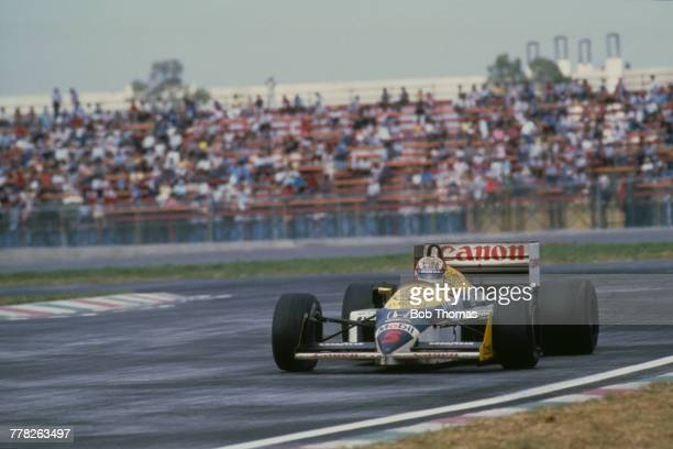 British racing driver Nigel Mansell drives the Canon Williams Honda Williams FW11 Honda RA166E 1.5 V6t in a race during the 1986 FIA Formula One...
