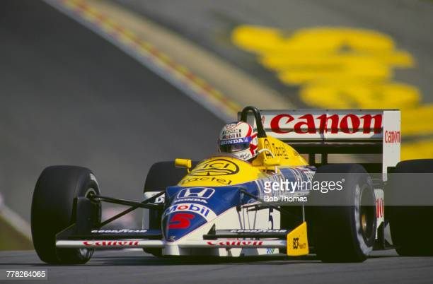 British racing driver Nigel Mansell drives the Canon Williams Honda Williams FW11 Honda RA166E 15 V6t to finish in first place to win the 1986...