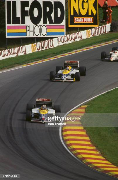 British racing driver Nigel Mansell drives the Canon Williams Honda Williams FW11 Honda RA166E 15 V6t ahead of teammate Nelson Piquet to finish in...