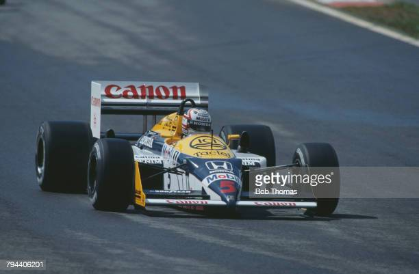 British racing driver Nigel Mansell drives the Canon Williams Honda Williams FW11B Honda RA167E 15 V6t in the 1987 Belgian Grand Prix at the Circuit...