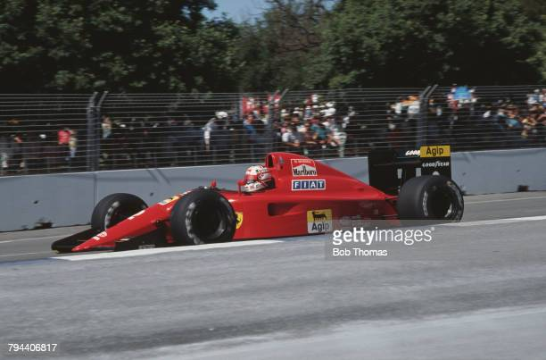 British racing driver Nigel Mansell drives the Scuderia Ferrari SpA Ferrari 641/2 Ferrari 037 35 V12 racing car to finish in 2nd place in the 1990...