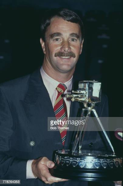 British racing driver Nigel Mansell holds the trophy after winning the 1992 BBC Sports Personality of the Year Award in London in December 1992