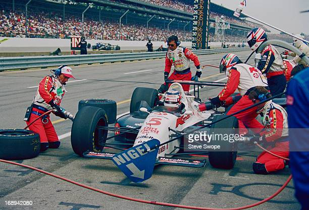 British racing driver Nigel Mansell stops at the pits for fuel and a tyre change during the 77th Indianapolis 500 at the Indianapolis Motor Speedway,...