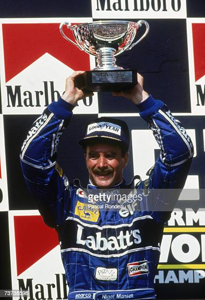 British racing driver Nigel Mansell wins the Formula One Drivers Championship with 2nd place during the Hungarian Grand Prix at Hungaroring, 1992.