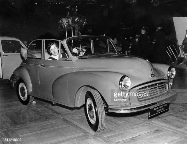 British racing driver Pat Moss arrives in a Morris Minor 1000 Convertible, for a preview of the 1956 motor show, which opens at Earls Court, October...