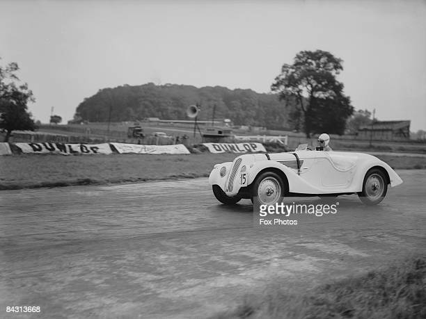 British racing driver Richard Seaman rounds Red Gate corner at Donington Park in a German BMW during training for the next day's Tourist Trophy 2nd...