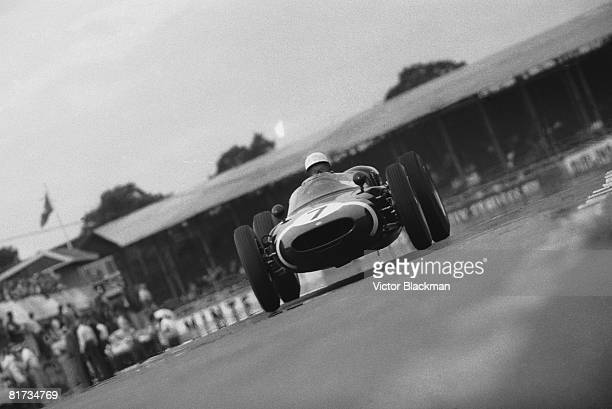British racing driver Stirling Moss at Silverstone 7th July 1961