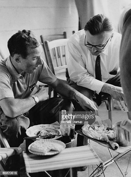 British racing driver Stirling Moss breaks for a meal during the 24 Hours of Le Mans in France, June 1953. Original Publication : Picture Post - 6558...
