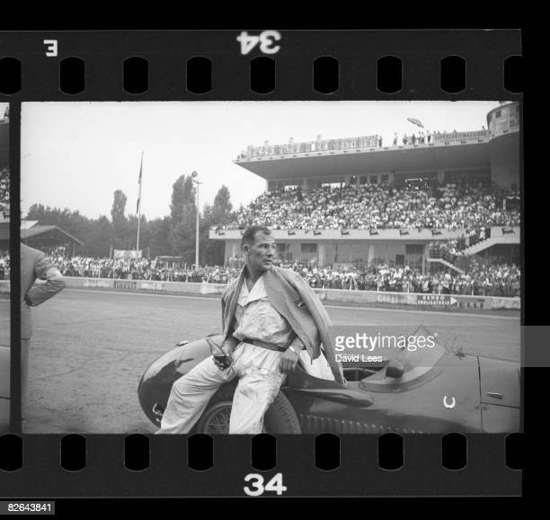British racing driver Stirling Moss in the pits at Monza where he is driving for Maserati in the Italian Grand Prix 5th September 1954 Original...