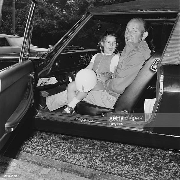 British racing driver Stirling Moss with his daughter Allison, on their way to Brands Hatch, UK, 3rd July 1971.