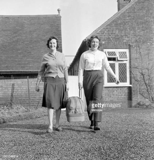 British racing drivers Ann Wisdom and Pat Moss after their victory in the Ladies Cup race in the Monte Carlo rally, with a bag packed ready to take...