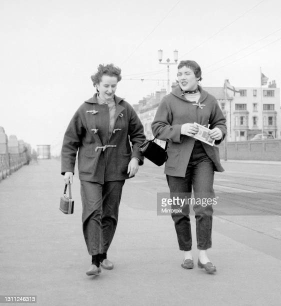 British racing drivers Ann Wisdom and Pat Moss both aged 21, take a brisk walk along the promenade in Blackpool, the day before for the start of the...