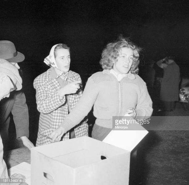 British racing drivers Ann Wisdom and Pat Moss check in looking tired after finishing the International RAC rally at Crystal Palace, 23rd November...