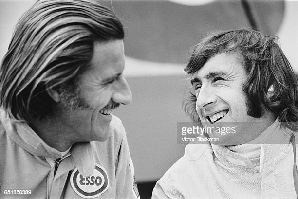 British racing drivers Graham Hill and Jackie Stewart during practice at Silverstone, UK, 16th July 1971.