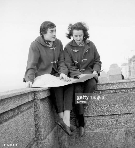 British racing drivers Pat Moss and Ann Wisdom both aged 21, study their map on the promenade in Blackpool, the day before for the start of the RAC...