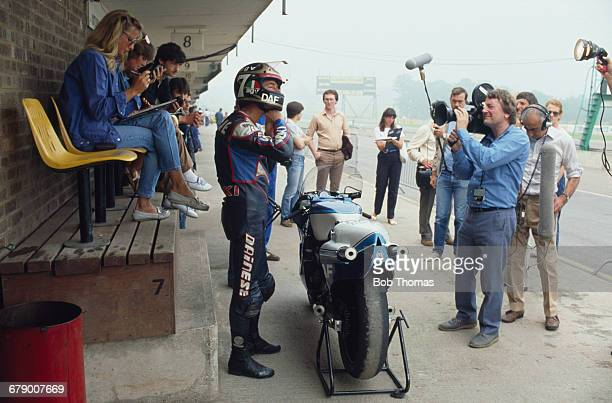 British racing motorcyclist Barry Sheene is filmed next to his Heron DAF Suzuki 500cc motorcycle during the International Gold Cup meeting at...