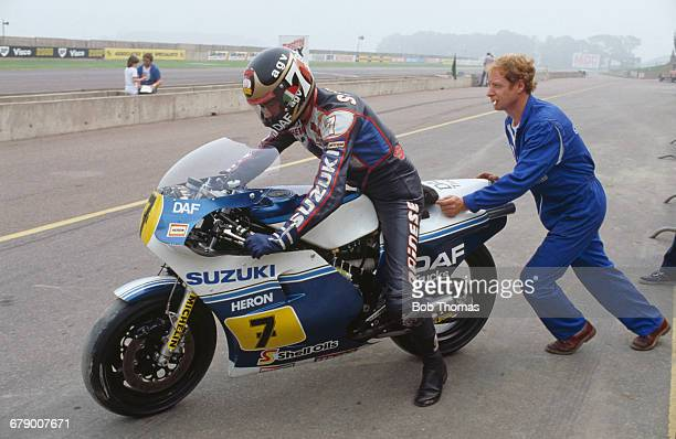 British racing motorcyclist Barry Sheene is pushed out on his Heron DAF Suzuki 500cc motorcycle during the International Gold Cup meeting at...