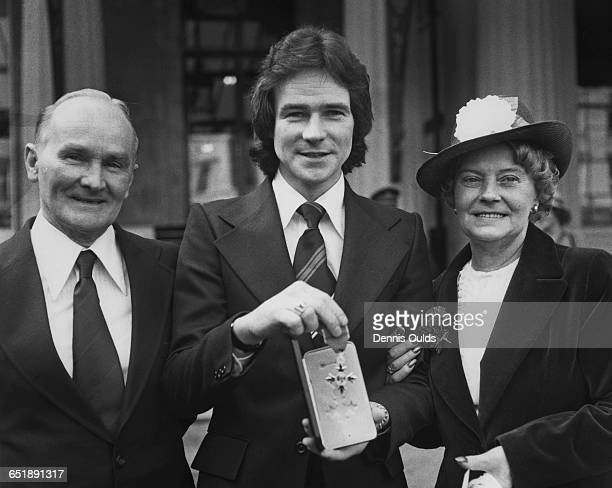 British racing motorcyclist Barry Sheene outside Buckingham Palace with his father Frank and mother Iris after receiving his OBE London 7th March 1978