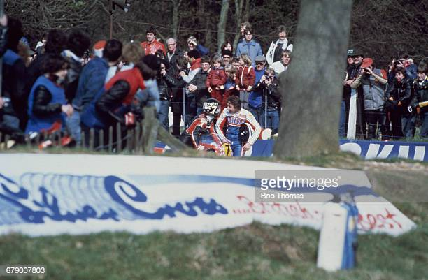 British racing motorcyclist Barry Sheene talking to Freddie Spencer of the USA after the American's fall on the last lap in a Transatlantic Trophy...