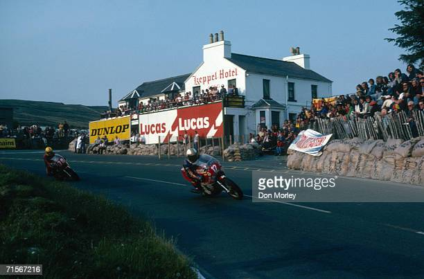 British racing motorcyclist Mike Hailwood leading Joey Dunlop down Mountain Road in the Formula One race at the Isle of Man TT races, June 1978....