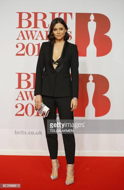 British radio DJ Lilah Parson poses on the red carpet on arrival for the BRIT Awards 2018 in London on February 21 2018 / AFP PHOTO / Tolga AKMEN /...