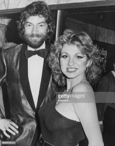 British radio presenter Adrian Love and gameshow presenter Debbie Arnold attend the London premiere of the film 'Grease' at the Empire Leicester...