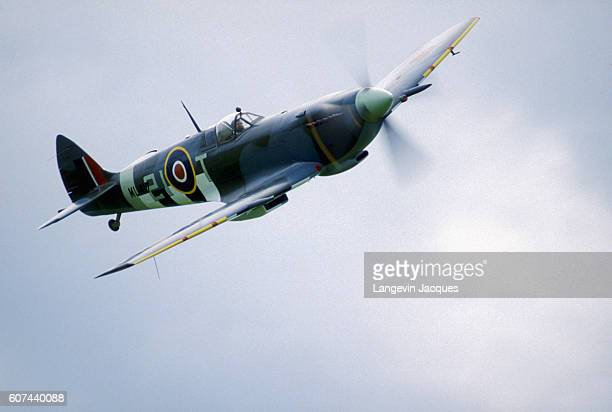 A British RAF Spitfire plane soars above the fields of Normandy where a World War II fighter plane air show celebrates the 40th anniversary of the US...