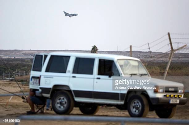 British RAF tornado fighter jets prepares to land on an airstrip at RAF Akrotiri after returning from a mission over Iraq on September 27 2014 in...