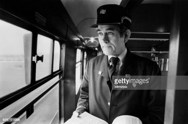 British Rail guard Tom Starkie of Stonegarth, at work on the Carlisle to Settle railway on 18th February 1984.