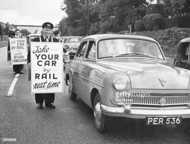 British Rail sandwichboard men advising stationary motorists to take the train instead