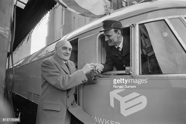 British Railway chairman Henry Johnson and driver Sidney Gadsby, driving a HS 4000 Kestrel diesel locomotive built by Hawker Siddleley for a test...