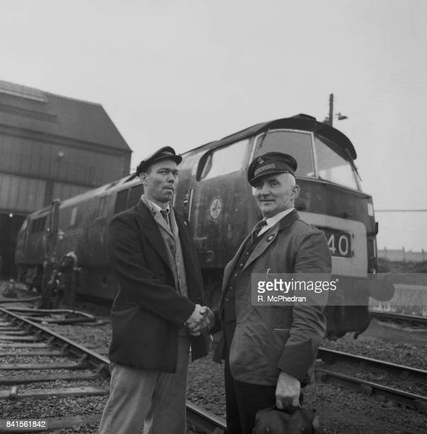 British Railways drivers shake hands in occasion of the record train run of the 'Western Lancer', a British Rail Class 52 locomotive, from London...