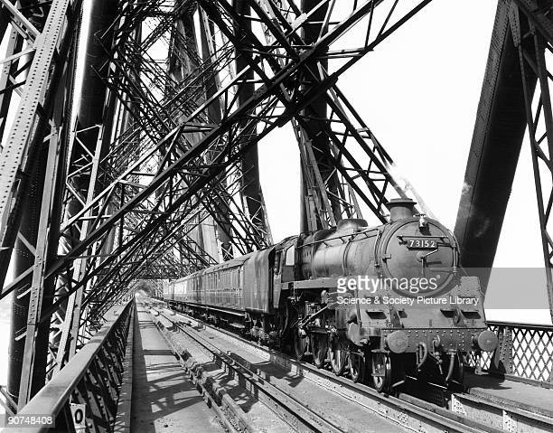 British Railways' Standard Class 5 steam locomotive crossing the Forth Bridge with a local train heading for Edinburgh c 1958 Photograph by Bishop...