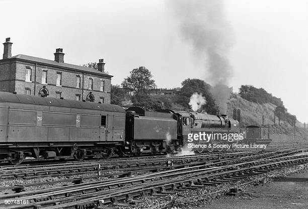 British Railways Standard Class 7P6F 462 steam locomotive No 70015 'Apollo' with goods train leaving Wakefield Kirkgate Photograph by Bishop Eric...