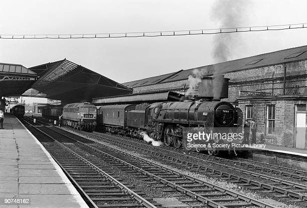 British Railways Standard Class 7P6F 462 steam locomotive No 70015 'Apollo' with goods train standing at Wakefield Kirkgate Alongside is Type 4 CoCo...